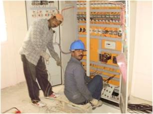 Technician from IISC, installing the systems control panel.  