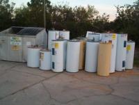 Water Heater Tank - Charcoal Retort: Free junked water heaters outside a local plumbing contractor's shop.